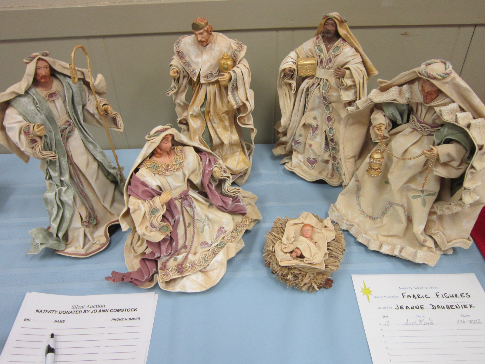 Nativity set fabric figures donated for auction.JPG