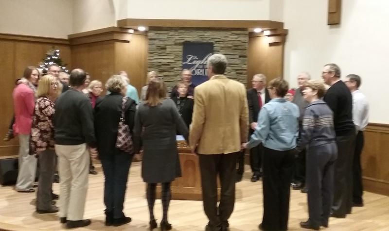 Central Christian members praying CROPPED.jpg