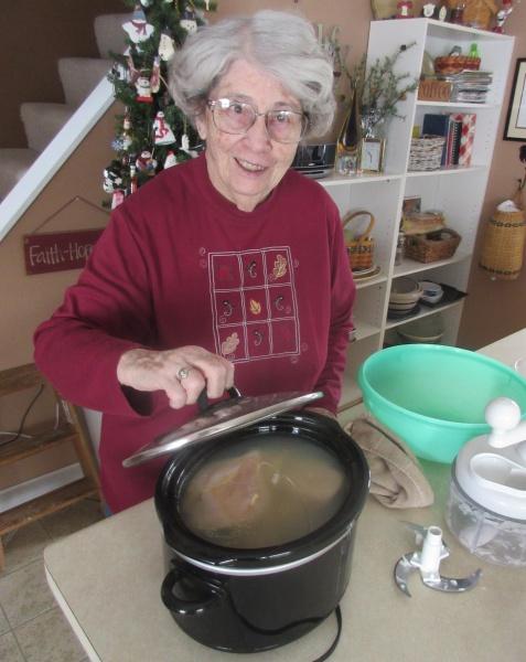 Sue Burt checking chicken.JPG