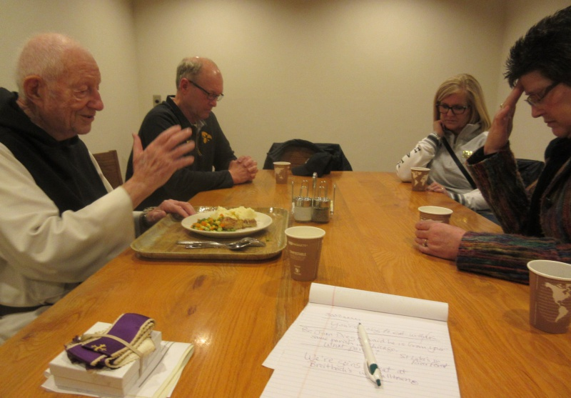 Father O'Connor blessing at lunch.JPG
