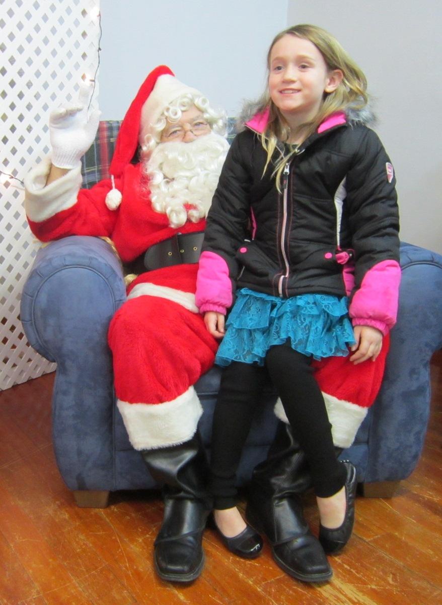 Hammond girl with Santa at Central Christian Church Dec 15.JPG