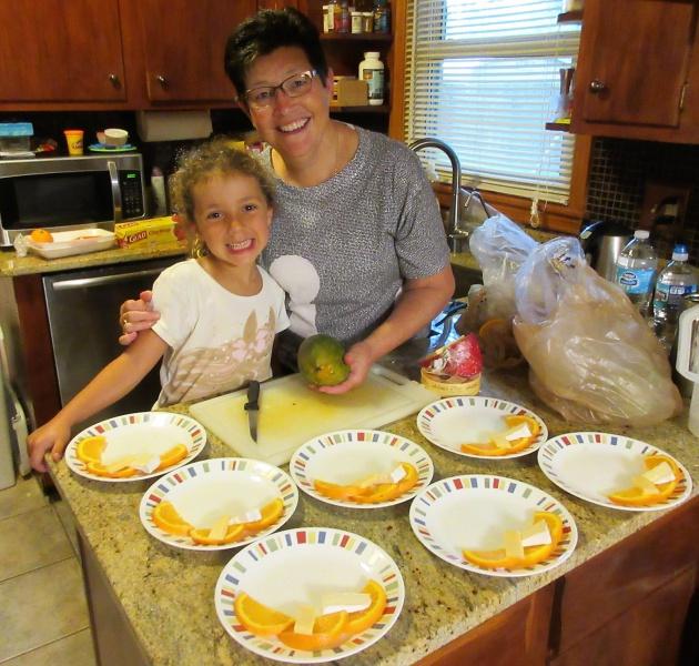 June Casey & Carla getting fruit & cheese plates ready 1.JPG