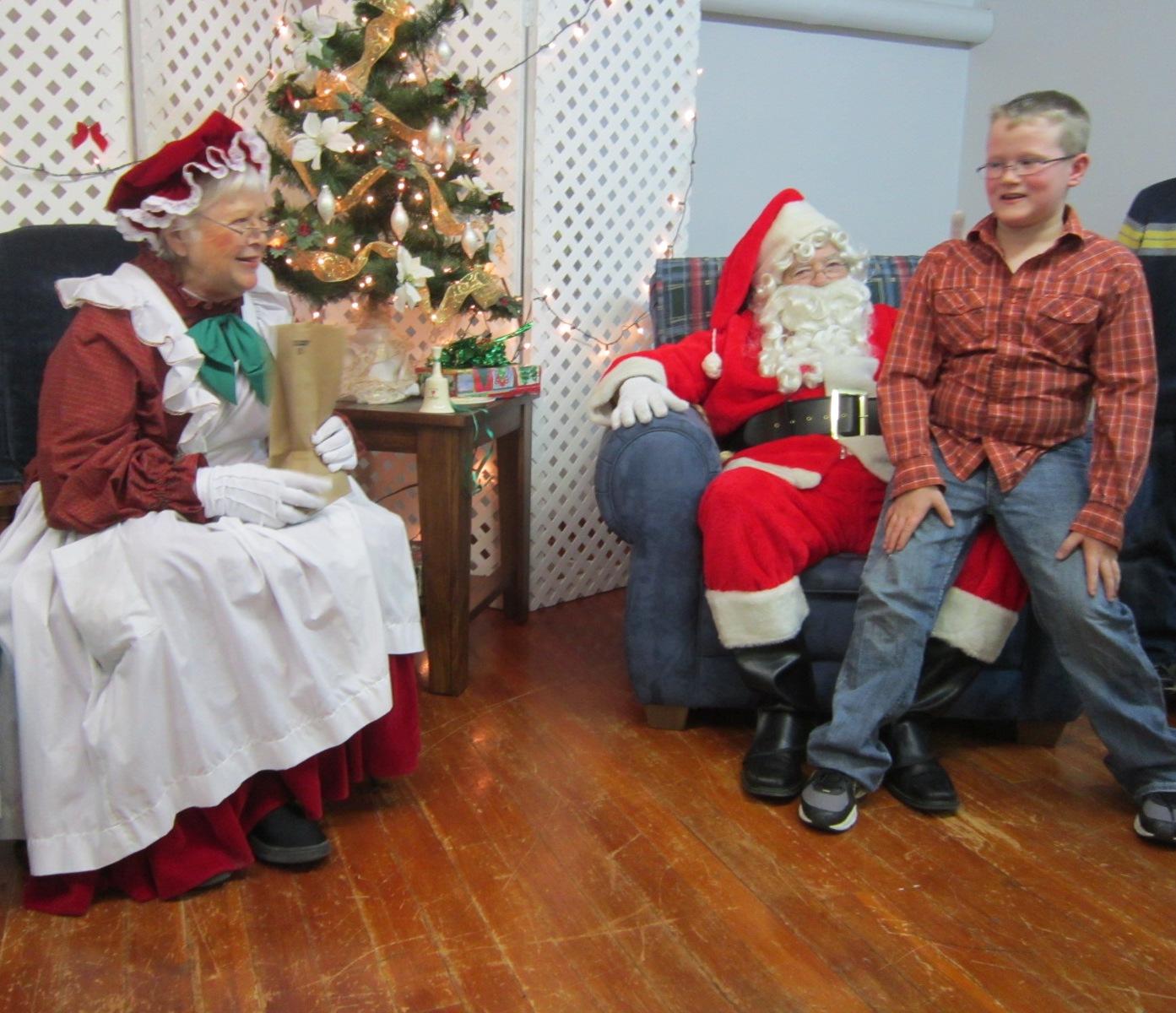 Boy With Santa & Mrs. Claus.JPG