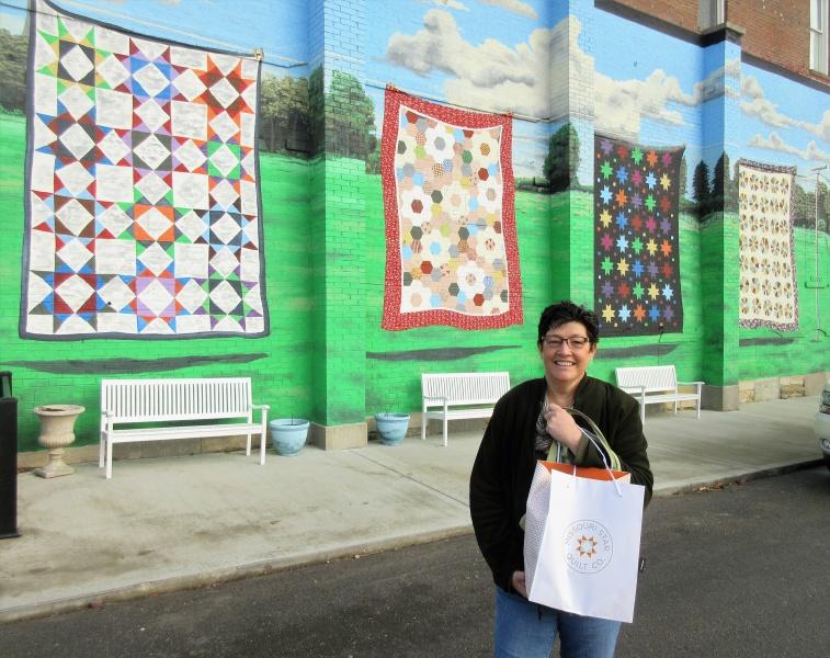 Carla O at quilt mural.JPG