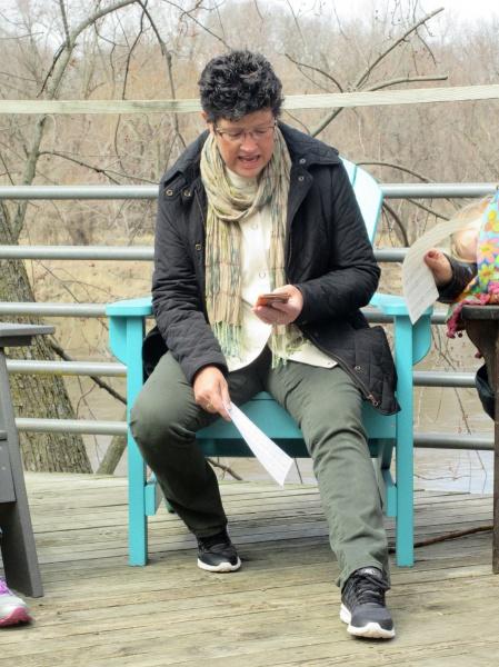 Carla O reading her favorite Bible verse.JPG