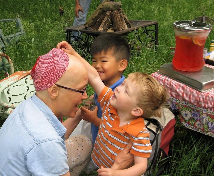 Checking grandma's bald head during campout.jpg