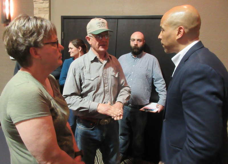 Mari & Leo Schultes of Coon Rapids with Sen Booker.JPG