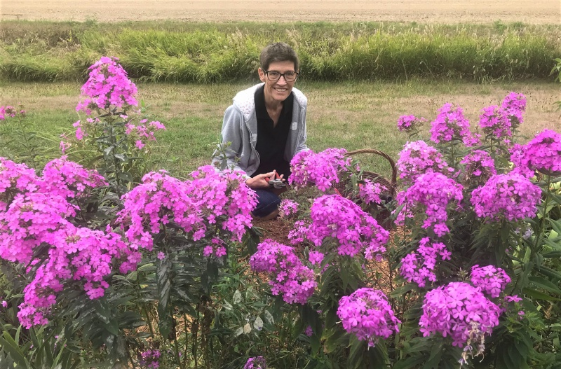 Carla in phlox out front.jpg