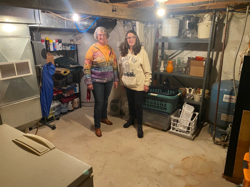 Chris & Tammie in basement they cleaned.jpg