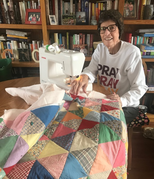 Carla sewing quilt for Suzan 2.jpg