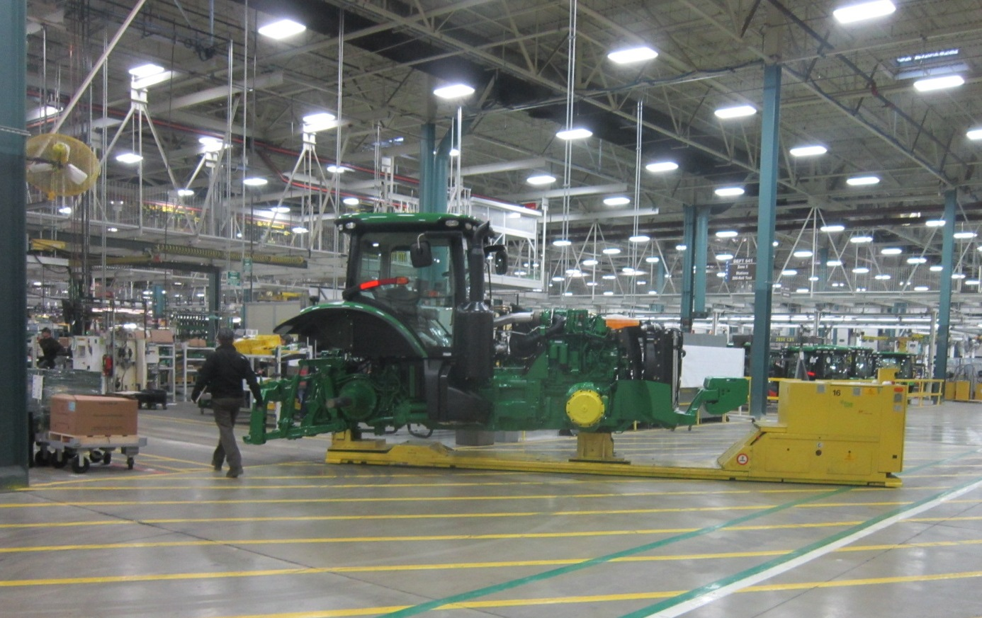 Unmanned frog moves tractor along assembly.JPG