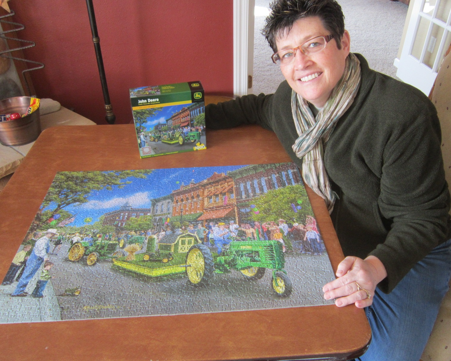 Carla O with finished John Deere puzzle.JPG