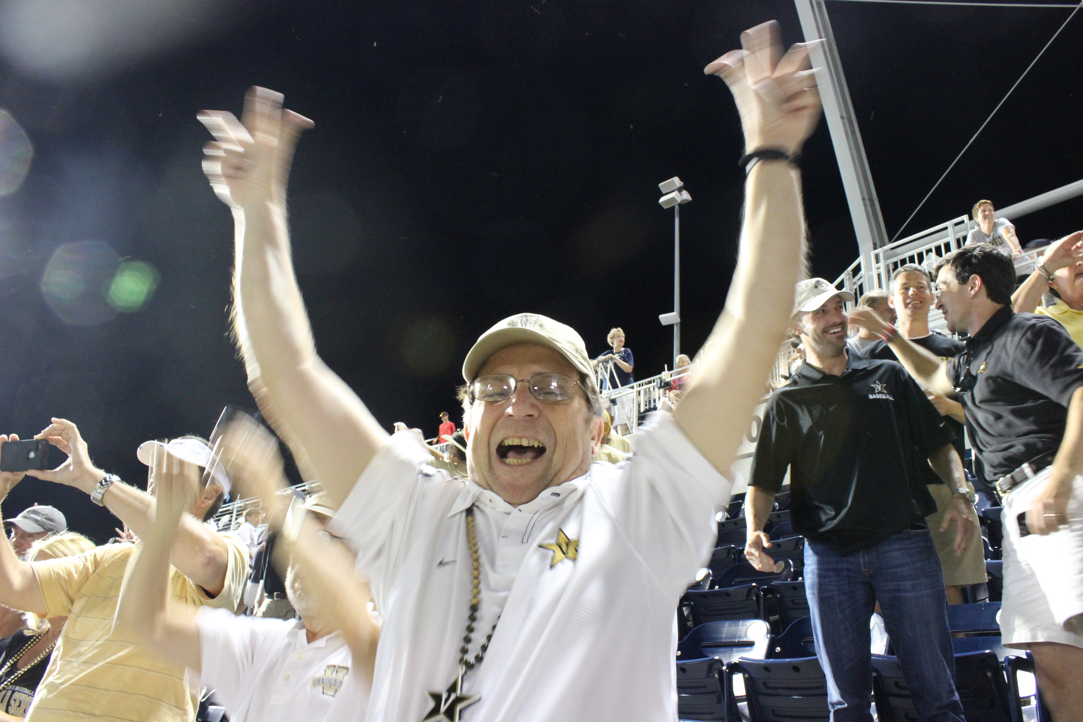 Chuck O Vandy fans whoop it up for CWS title.JPG