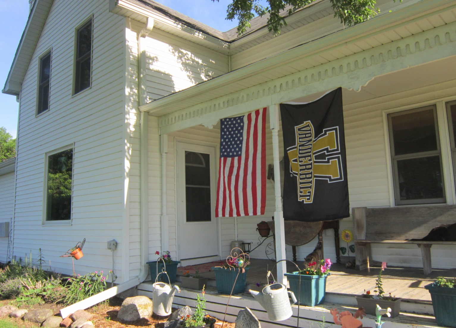 Flags flying at the farmhouse today June 24.JPG