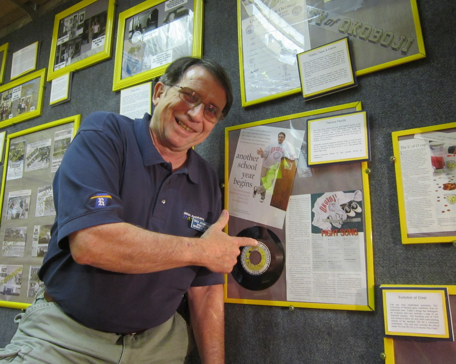 Chuck O at his spot on wall of fame U of Okoboji July 20.JPG