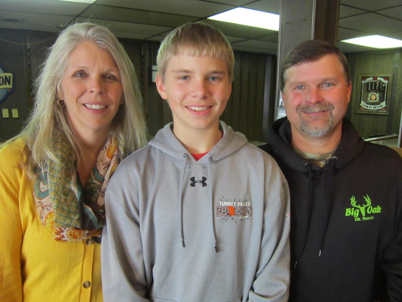Cole Langreck with parents Karla and Henry Langreck.JPG