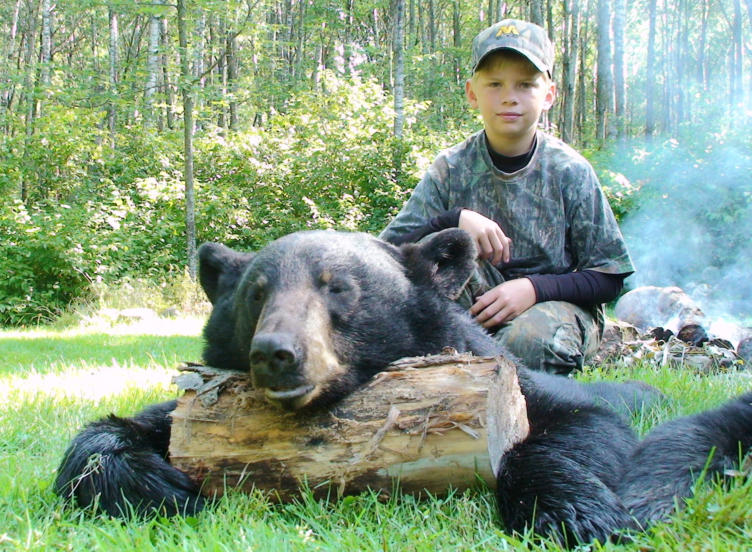 Young Cole Langreck with bear he shot.JPG