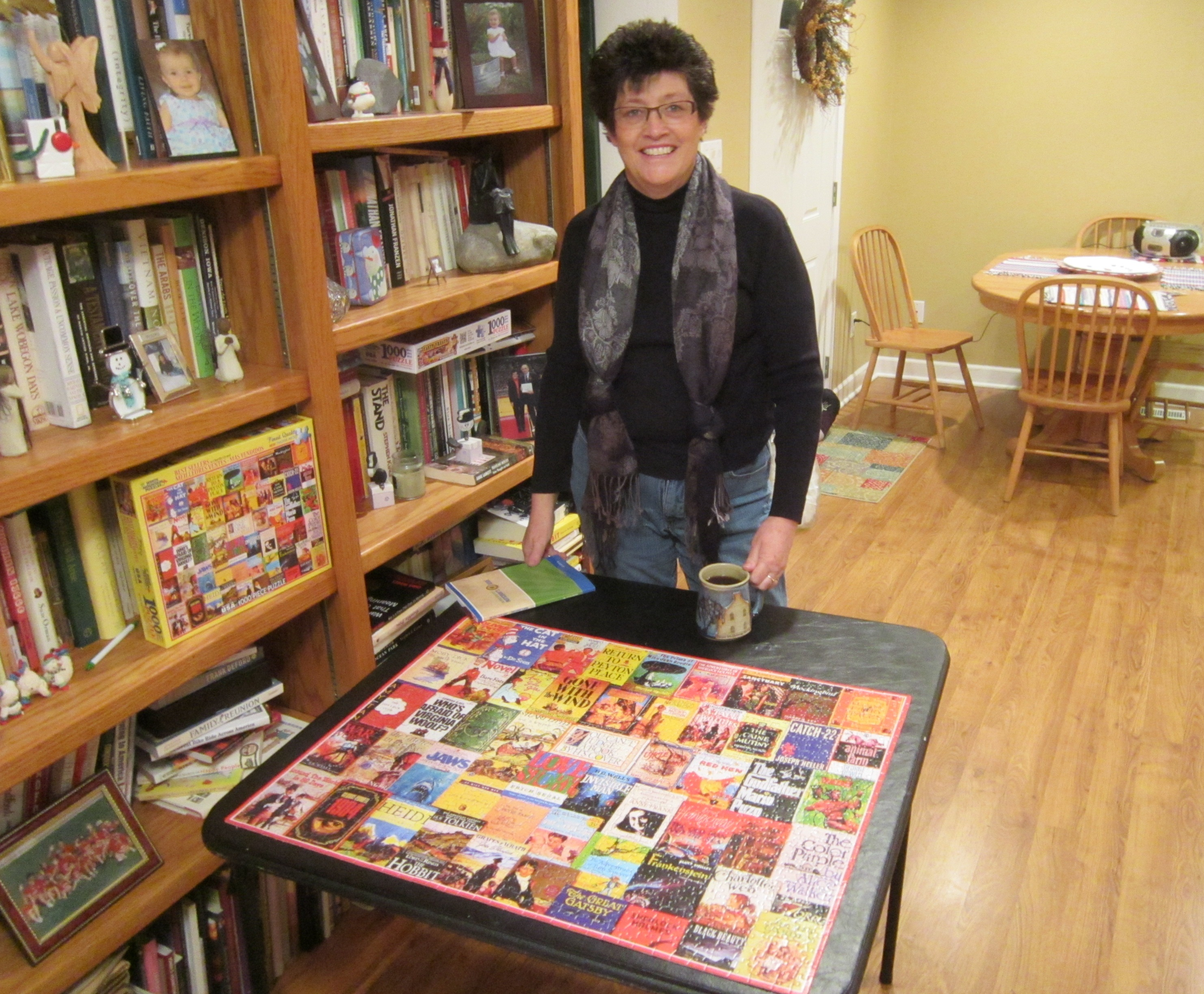 Carla with a puzzle of best sellers covers.JPG