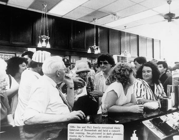 Everly Brothers at soda fountain 1986.jpg