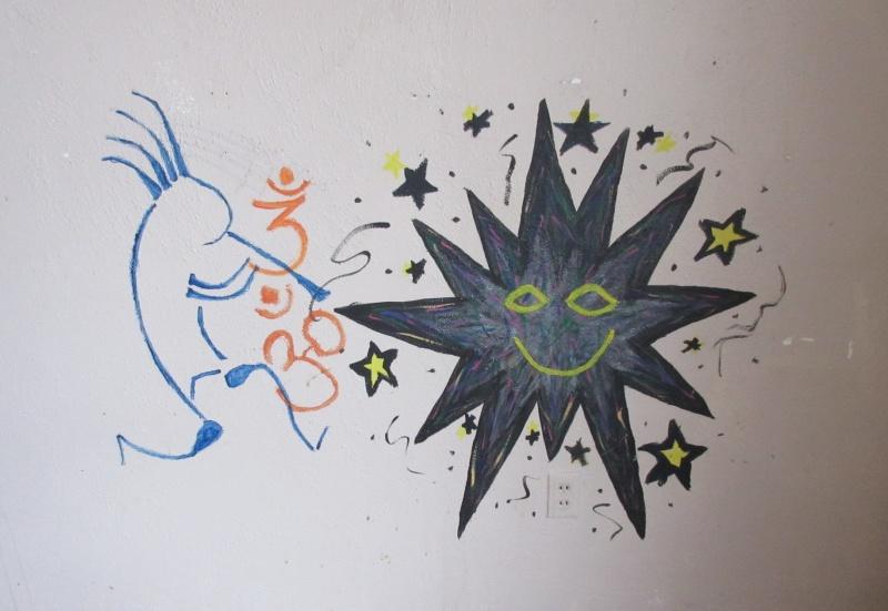 Grafitti art left on an apartment wall.JPG