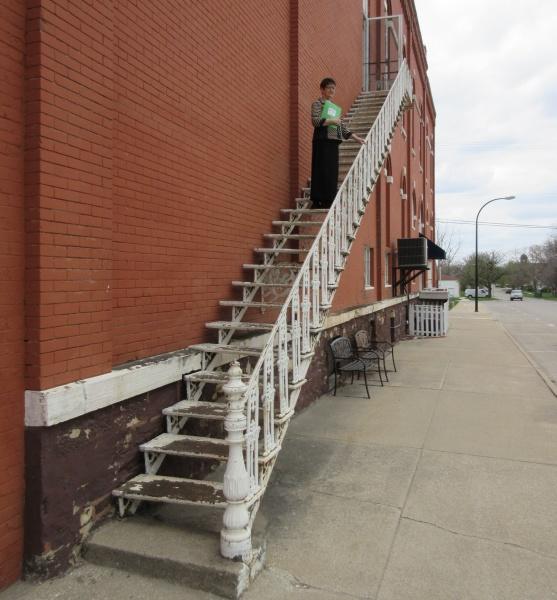Carla Offenburger on staircase of corner bldg B.JPG