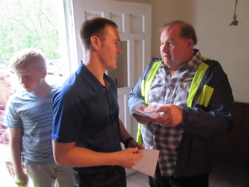 2 Dave Coon hands out programs at Pleasant Hill Church.JPG