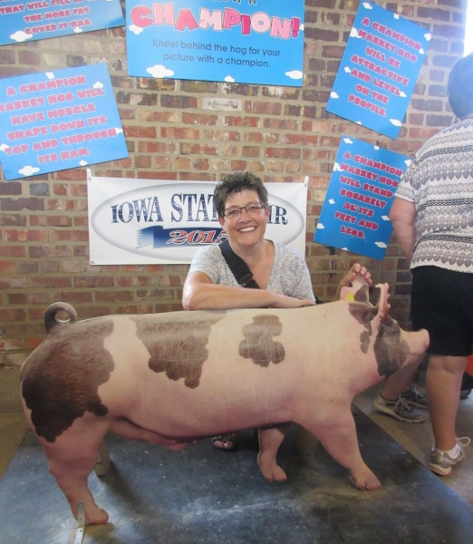 Carla Offenburger with champion pig, sort of.JPG