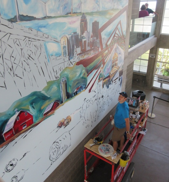 Ben Schuh painting mural during fair 2 CROPPED.JPG