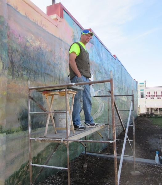 12 Jones on scaffold foreground of mural in Oakland - Copy.JPG