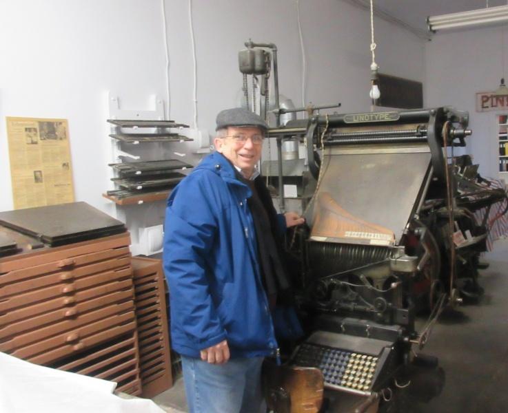 22 Chuck O with linotype machine in Diagonal museum.JPG