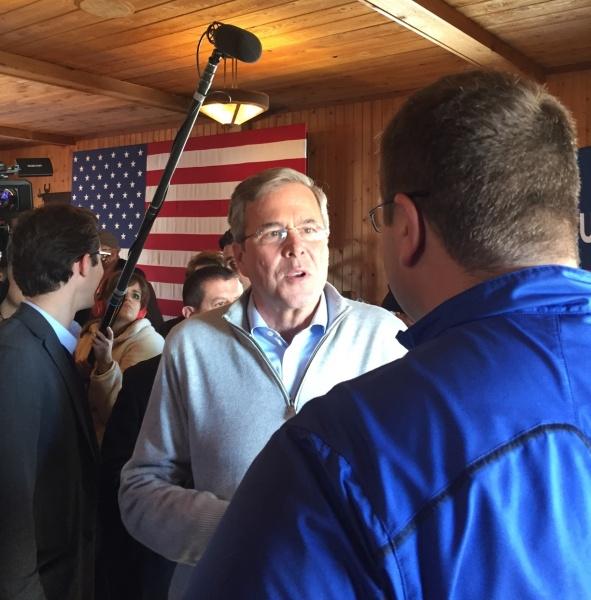 Jeb Bush chats with Carl Behne Jan 29.jpg