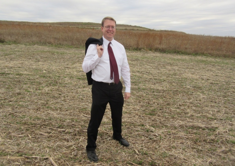 Rob Hogg in a Whiterock bean field with cover crop coming.JPG